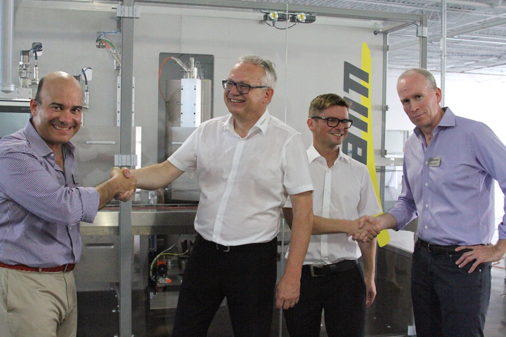 shaking hands at karlville industrial business