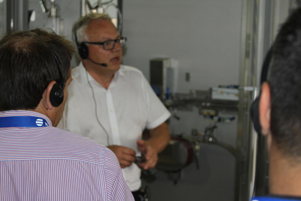 visitors in packaging production plant