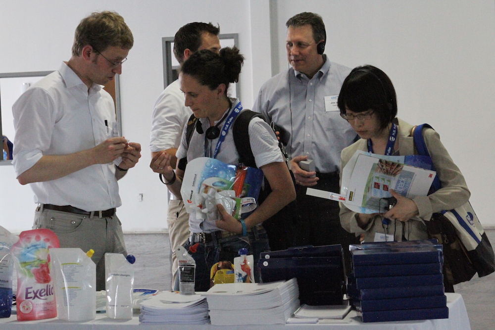 engineers in spout bag packaging demostration